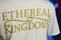 Backside detail with the Ethereal Kingdoms logo in vintage gold.